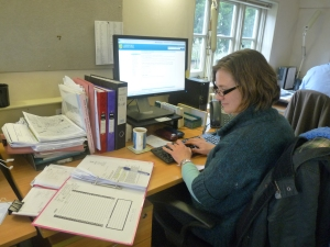 Vanessa working at her desk at Kent Wildlife Trust, reviewing the ecological information from a planning application
