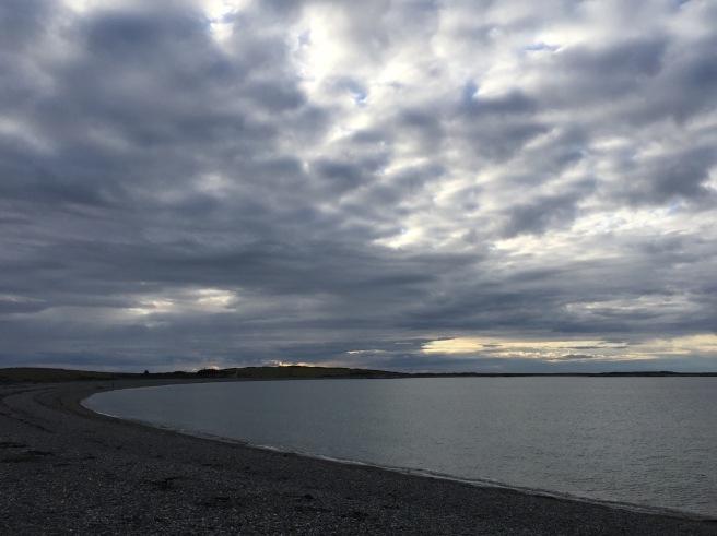 Cemlyn Bay under a dark sky