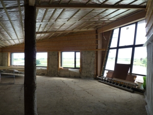 inside Huxley Visitor centre under construction, the packed earth floor