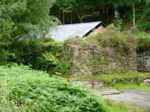 Blast wall and building at Gwaith Powdwr